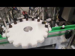 kleine machine voor het vullen van vloeibare flessen